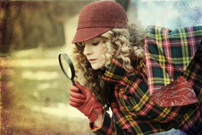 young beauty woman with magnifier glass and hat, vintage
